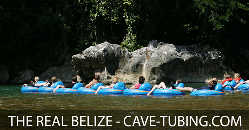 Group of Carnival cruise passengers Cave Tubing in Belize